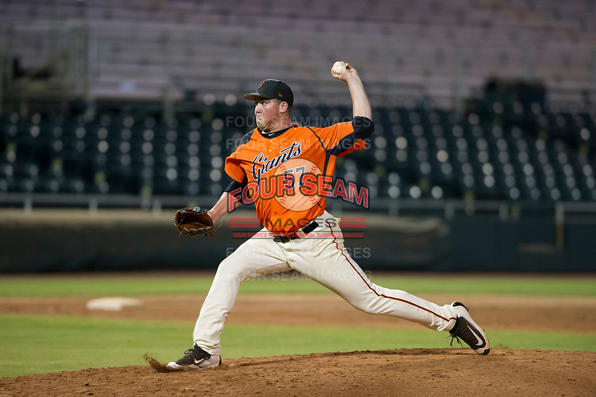 AZL Giants relief pitcher John Gavin (57) delivers a pitch to the plate against the AZL Cubs on September 5, 2017 at Scottsdale Stadium in Scottsdale, Arizona. AZL Cubs defeated the AZL Giants 10-4 to take a 1-0 lead in the Arizona League Championship Series. (Zachary Lucy/Four Seam Images)