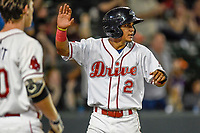 Shortstop Santiago Espinal (2) of the Greenville Drive reacts after scoring a run in Game 4 of the South Atlantic League Championship Series against the Kannapolis Intimidators on Friday, September 15, 2017, at Fluor Field at the West End in Greenville, South Carolina. Greenville won 8-3 for the team's first SAL Championship, winning the series 3-1. (Tom Priddy/Four Seam Images)