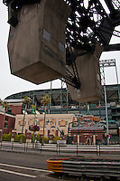 The concrete bascule, or counterweight, of the Lefty O'Doul Bridge with the entrance to San Francisco's AT&T park in the background.