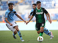 Football, Serie A: S.S. Lazio - Sassuolo, Olympic stadium, Rome, July 11, 2020. <br /> Sassuolo's  Giacomo Raspadori (r) in action with Lazio's Marco Parolo (r) during the Italian Serie A football match between S.S. Lazio and Sassuolo at Rome's Olympic stadium, Rome, on July 11, 2020. <br /> UPDATE IMAGES PRESS/Isabella Bonotto