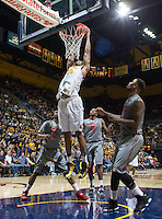 Jordan Mathews of California dunks the ball during a game against Washington State at Haas Pavilion in Berkeley, California on January 5th, 2014. California defeated Washington State 76 - 55