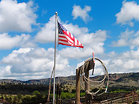 The American flag flying at the Black Hills Wild Horse Sanctuary in South Dakota. Blue skies, billowy white clouds and a lariat make a truly American scene. I'm thinking John Wayne would have really loved this one.