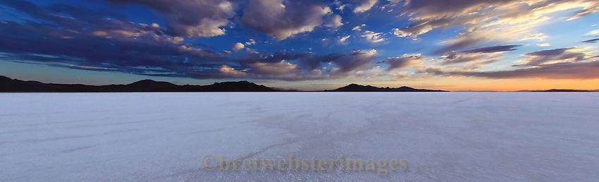 The sun rises on the vast expanse of salt at the Bonneville Salt Flats in Utah.