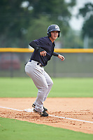 GCL Yankees West left fielder Dario Unda (9) leads off third base during the first game of a doubleheader against the GCL Yankees East on July 19, 2017 at the Yankees Minor League Complex in Tampa, Florida.  GCL Yankees West defeated the GCL Yankees East 11-2.  (Mike Janes/Four Seam Images)