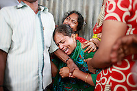 People and relatives mourn in the bank of river Padma.  Today the Pinak-6, a passenger vessel sank in the middle of the river Padma on its way to Mawa from Kawrakandi terminal at around 11 PM today. The boat capsized since the river was rough due to the stormy weather. At least 250 people were in the capsized boat. Local people rescued nearly 45 passengers from the river and many other are still missing. Stormy weather and strong current hamper the rescue operation. Mawa, Munshigonj, near Dhaka, Bangladesh