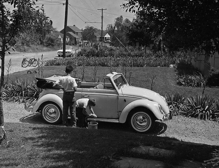 Bethel Park PA:  View of Michael Stewart washing the Stewart's new Volkswagen Beetle convertible.  Brady Stewart III is supervising the activity.