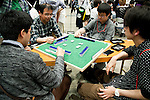 """Visitors play a card game at the Niconico Douga fan event at Makuhari Messe International Exhibition Hall on April 25, 2015, Chiba, Japan. The event includes special attractions such as J-pop concerts, Sumo and Pro Wrestling matches, cosplay and manga and various robot performances and is broadcast live on via the video-sharing site. Niconico Douga (in English """"Smiley, Smiley Video"""") is one of Japan's biggest video community sites where users can upload, view, share videos and write comments directly in real time, creating a sense of a shared watching. According to the organizers more than 200,000 viewers for two days will see the event by internet. The popular event is held in all 11 halls of the huge Makuhari Messe exhibition center from April 25 to 26. (Photo by Rodrigo Reyes Marin/AFLO)"""