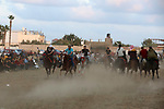 Palestinians ride horses and camels during a local race, in Nuseirat, in the center of Gaza strip on October 8, 2021. Breeders of Arabian horses in Gaza have been struggling to secure the necessary medicines and vaccinations due to Israeli restrictions. Horse breeding in Gaza, is limited to a certain group of amateurs because of their high prices involved. Photo by Ashraf Amra