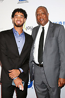 LOS ANGELES - AUG 20:  Johnny Juzang, Jamaal Wilkes at the 21st Annual Harold and Carole Pump Foundation Gala at the Beverly Hilton Hotel on August 20, 2021 in Beverly Hills, CA