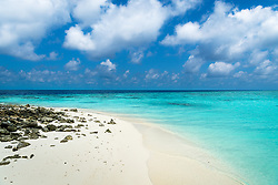 White powdery sand meets aquamarine water on one of approximately 900 uninhabited islands in the Maldives.