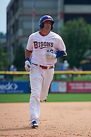 Buffalo Bisons first baseman Matt Hague (16) runs the bases after hitting a home run during a game against the Columbus Clippers on July 19, 2015 at Coca-Cola Field in Buffalo, New York.  Buffalo defeated Columbus 4-3 in twelve innings.  (Mike Janes/Four Seam Images)