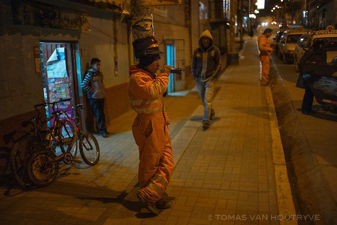 Miners are seen in the Parasha neighborhood of Cerro de Pasco on June 25, 2013.