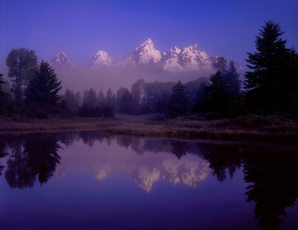 Morning fog and the Snake River, reflection ofGrand Teton Peak, Grand Teton National Park; Jackson Hole; Wyoming, USA. John offers private photo tours in Grand Teton National Park and throughout Wyoming and Colorado. Year-round.