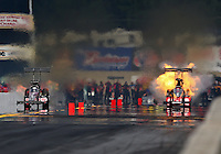 Oct 6, 2013; Mohnton, PA, USA; NHRA top fuel dragster driver David Grubnic (right) explodes his engine in a fireball alongside Bob Vandergriff Jr during the Auto Plus Nationals at Maple Grove Raceway. Mandatory Credit: Mark J. Rebilas-