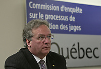 Jean-Francois Bertrand listens as commissioner Michel Bastarache unveils the report of his inquiry in the appointment of judges, commonly know as the Commission Bastarache, Wednesday January 19, 2011.<br /> <br /> PHOTO :  Francis Vachon - Agence Quebec Presse