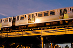 """The Chicago """"L"""" train passes over a local street in Lincoln Park, Chicago, Illinois"""