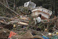 A fishing vessel lies deep in a Hachinohe wooded area after being swept inland by a tsunami. An 8.9-magnitude earthquake triggered this tsunami that impacted Japan's eastern coastline causing serve damage and untold loss of life.