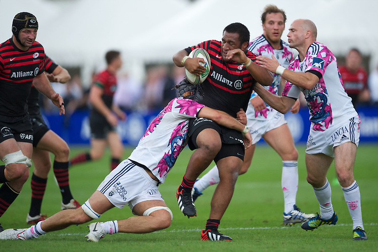 20120823 Copyright onEdition 2012©.Free for editorial use image, please credit: onEdition..Man of the Match Mako Vunipola of Saracens is tackled at The Honourable Artillery Company, London in the pre-season friendly between Saracens and Stade Francais Paris...For press contacts contact: Sam Feasey at brandRapport on M: +44 (0)7717 757114 E: SFeasey@brand-rapport.com..If you require a higher resolution image or you have any other onEdition photographic enquiries, please contact onEdition on 0845 900 2 900 or email info@onEdition.com.This image is copyright the onEdition 2012©..This image has been supplied by onEdition and must be credited onEdition. The author is asserting his full Moral rights in relation to the publication of this image. Rights for onward transmission of any image or file is not granted or implied. Changing or deleting Copyright information is illegal as specified in the Copyright, Design and Patents Act 1988. If you are in any way unsure of your right to publish this image please contact onEdition on 0845 900 2 900 or email info@onEdition.com