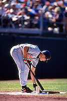 OAKLAND, CA - Cal Ripken of the Baltimore Orioles gets ready to bat in the on deck circle during a game against the Oakland Athletics at the Oakland Coliseum in Oakland, California in 1996. Photo by Brad Mangin