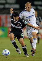 2006 MLS Regular Season Match at RFK Stadium, DC United foward Alecko Eskandarian fighting for the ball against defender from Kansas City Matt Groenwald during the game--final score DC United  2, KC Wizards 1, Saturday, May 13, 2006.