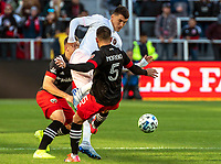WASHINGTON, DC - MARCH 07: Junior Moreno #5 of DC United tackles Robbie Robinson #19 of Inter Miami during a game between Inter Miami CF and D.C. United at Audi Field on March 07, 2020 in Washington, DC.