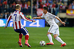 Atletico de Madrid's Griezmann (L) and Real Madrid´s James Rodriguez during quarterfinal first leg Champions League soccer match at Vicente Calderon stadium in Madrid, Spain. April 14, 2015. (ALTERPHOTOS/Victor Blanco)