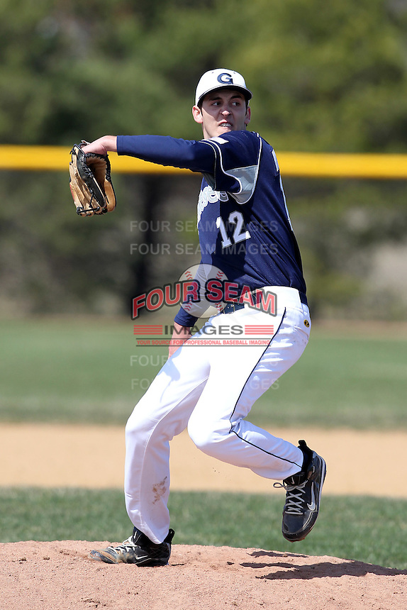 Genesee Community College Cougars pitcher Alex Hondromatidis #12 delivers a pitch during a game against the Ithaca JV team at Genesee Community College on April 9, 2011 in Batavia, New York.  Photo By Mike Janes/Four Seam Images