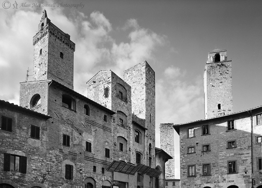"""""""Five Towers""""<br /> San Gimignano, Italy<br /> 2015<br /> <br /> Tall medieval towers, built for protection and as symbols of wealth, rise above the streets of San Gimignano.  Most of these structures have vanished, but fourteen towers survived to remind visitors of their importance.<br /> <br /> 4 x 5 Large Format Film"""