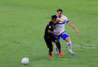 LOS ANGELES, CA - SEPTEMBER 02: Latif Blessing #7 of LAFC pushes off Cade Cowell #44 of the San Jose Earthquakes during a game between San Jose Earthquakes and Los Angeles FC at Banc of California stadium on September 02, 2020 in Los Angeles, California.