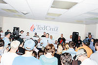 Texas senator and Republican presidential candidate Ted Cruz greets people before speaking at the kick-off event at his New Hampshire campaign headquarters in Manchester, New Hampshire.