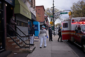 April 18, 2020<br /> Brooklyn, New York<br /> Park Slope<br /> <br /> EMS and the NYPD on the streets of Park Slope remove someone from their home. This is a common scene throughout New York City ad the coronavirus takes hold during the pandemic.