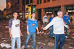 © Joel Goodman - 07973 332324 - all rights reserved . 14/05/2008 . Manchester , UK . Approximately 200,000 Glasgow Rangers fans travel to Manchester to watch their team's UEFA Cup final match against Zenit Saint Petersburg on big screens at locations around Manchester City Centre . Subsequent to the screen located at Piccadilly Gardens either being turned off or failing mid-match , some fans clashed with riot police . Photo credit : Joel Goodman