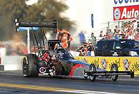 Feb. 14, 2013; Pomona, CA, USA; NHRA top fuel dragster driver Larry Dixon during qualifying for the Winternationals at Auto Club Raceway at Pomona.. Mandatory Credit: Mark J. Rebilas-