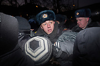 Police push back protesters during an illegal protest against Putin in Lubyanka Square in Moscow, Russia.