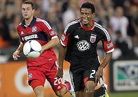 WASHINGTON, DC. - AUGUST 22, 2012:  Lionard Pajoy (26) of DC United breaks away from  Austin Berry (22) of the Chicago Fire during an MLS match at RFK Stadium, in Washington DC,  on August 22. United won 4-2.