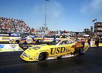 Jul. 28, 2013; Sonoma, CA, USA: NHRA funny car driver Jeff Arend (near lane) races alongside Ron Capps during the Sonoma Nationals at Sonoma Raceway. Mandatory Credit: Mark J. Rebilas-
