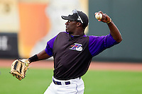 Jared Mitchell #24 of the Winston-Salem Dash throws in the outfield prior to fielding practice at BB&T Ballpark on May 7, 2011 in Winston-Salem, North Carolina.   Photo by Brian Westerholt / Four Seam Images