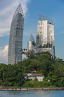 """Singapore Juxtaposition of Old and New: Daniel Libeskind's """"Reflections"""" in Background vs. Harbourmaster's 1920-era House in foreground.  The apparent curvature in the highrise apartrment building is not a result of lens distortion."""