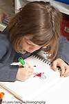 Education preschool 3-4 year olds art activity girl drawing with marker vertical