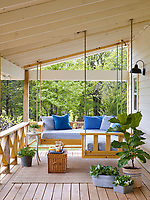 The front porch features a clever swinging L-shaped porch bed.