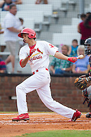 Carlos Torres (21) of the Johnson City Cardinals follows through on his swing against the Elizabethton Twins at Cardinal Park on July 27, 2014 in Johnson City, Tennessee.  The game was suspended in the top of the 5th inning with the Twins leading the Cardinals 7-6.  (Brian Westerholt/Four Seam Images)