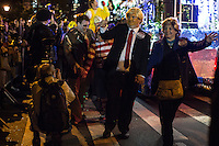 NEW YORK, NY - OCTOBER 31,2016. A pair dressed as Donald Trump and Hillary Clinton walks along Sixth Avenue during the 43rd annual Village Halloween Parade in Manhattan. October 31,2016. Photo by VIEWpress/Maite H. Mateo.