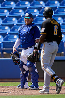 Toronto Blue Jays catcher Alejandro Kirk (30) jokes with Anthony Alford (6) before an at bat during a Major League Spring Training game against the Pittsburgh Pirates on March 1, 2021 at TD Ballpark in Dunedin, Florida.  (Mike Janes/Four Seam Images)