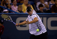 American Andy Roddick prepares for a forehand during the Legg Mason Tennis Classic at the William H.G. FitzGerald Tennis Center in Washington, DC.  Giles Simon defeated Andy Roddick in straight sets in a thunderstorm delayed evening session.