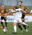 Dumbarton's Scott Agnew holds off Alloa's Graeme Holmes.