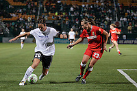 Abby Wambach (20) of the magicJack and Whitney Engen (23) of the Western New York Flash battle for control in the second half.  The Western New York Flash defeated the magicJack 3-0 in Women's Professional Soccer (WPS) at Sahlen's Stadium in Rochester, NY May 22, 2011.