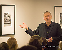 Al Luft talks about the lives behind his portraits on display in the Stream Gallery at Edgewood College in Madison.