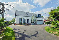 BNPS.co.uk (01202 558833)<br /> Pic: Mullucks/BNPS<br /> <br /> After the transformation...<br /> <br /> A retired couple dubbed 'the accidental upsizers' have put their luxury home on the market for a whopping £750,000.<br /> <br /> Jean and Desmond Lawton bought a suburban bungalow three years ago as they looked to downsize from a large property.<br /> <br /> But they soon decided that they didn't like the dated decour of the humble home and transformed it beyond recognition.<br /> <br /> They knocked down every internal retaining wall bar one to create an open-plan space and built a single-storey extension to the rear.