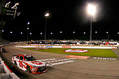 #20: Christopher Bell, Joe Gibbs Racing, Toyota Camry Rheem drives under the checkered flag to win