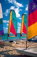 Colorful catamaran sailboats on beach. Nassau, Bahamas.